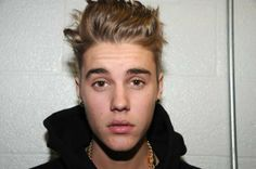 MIAMI BEACH, FL - MARCH 04: In this handout photo provided by the Miami Beach Police Department and released on March 4, 2014, singer Justin Bieber is photographed by police while in custody on January 23, 2014 in Miami Beach, Florida. Justin Bieber was arrested for driving under the influence, resisting arrest and driving without a valid driver's license. (Photo by Miami Beach Police Department via Getty Images)