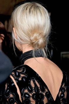 Fall 2014 Hair Trends - low bun @ Erdem.  Pull out a few pieces of hair to keep it youthful.