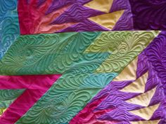 I tried to trace the original pinner, I think it's this person.  GORGEOUS quilting  Another view of the 2011 raffle quilt.