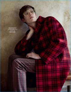 Felix Gesnouin dons a red check coat from Gucci for the pages of GQ Russia.