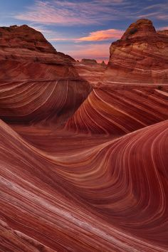 The Wave - Arizona, United States: The Wave is a sandstone rock formation located in the United States of America near the Arizona–Utah border, on the slopes of the Coyote Buttes, in the Paria Canyon-Vermilion Cliffs Wilderness, on the Colorado Plateau. It is famous among hikers and photographers for its colorful, undulating forms, and the rugged, trackless hike required to reach it.