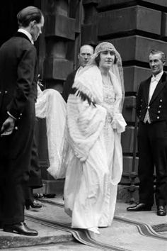 Lady Elizabeth Bowes-Lyon (the Queen Mother) wore a traditional full-length gown with a court train for her 1923 marriage to the Duke of York, later George VI. Designed by Madame Handley, the dress had an unshaped lace bodice, a style made popular by Coco Chanel.