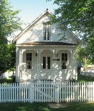 sweet little house with white picket fence