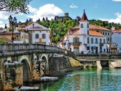 Tomar and Nabão River | The castle at the top of the hill is actually the Convent of Christ. #Portugal