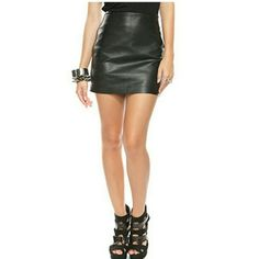 Faux leather skirt Never worn. It has a few unraveling treads has shown in the pictures. Ambiance Apparel Skirts