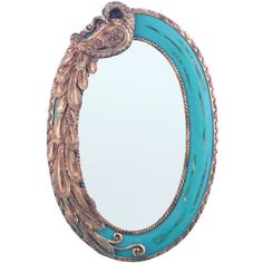 River of Goods 23.75-inch Oval Blue Peacock Mirror