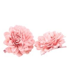 These hair clips are really cute for the price. We could bake cookies put them in cellophane baggies (which I have) tie with a ribbon and add a flowie hair clippie for favors. What do you think?