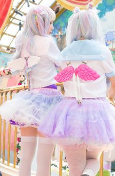 I love the pastel petticoat that the girls are wearing.