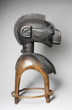 Africa | Head mask from the Baga people of Guinea | ca. late 19th to early 20th century | Wood, fiber and pigment | This type of mask ~ D'mba ~ is worn at important celebrations to ensure growth and fertility not only among the Baga people but also in terms of their crops and livestock.