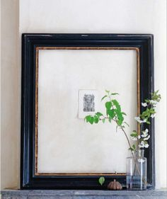Rather than diminishing the etching, the large framing draws attention to it.  This would be a lovely idea for a gift too: a small, beautiful piece of art in a vintage frame with a large mat.