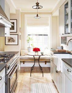 Galley kitchen with breakfast nook.