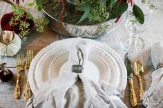 Elegant, traditional, moody Thanksgiving place settingwith hydrangeas, pink roses, amaranths, velvet pumpkins.