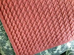 Free Pattern: Scarlett's Reversible Cable Baby Blanket by Suzanne Bryan
