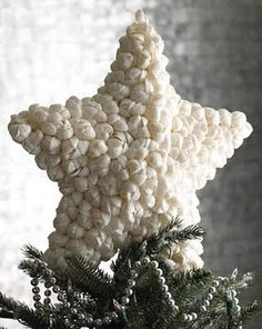 sea shell tree topper for a nautical themed tree! Sail boats, sea shells in clear glitter, light houses, blue and white stripes, seagulls instead of turtle doves.... could look really pretty!