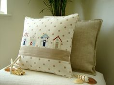 Beach Huts On The Sand Cushion. £20.00, via Etsy.