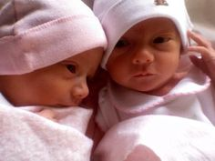 I love being a twin! This picture reminds me of my sister and I when we were born :)