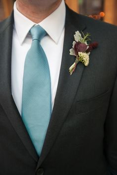 {{Fall wedding boutonniere with all locally grown flowers. Burnette, dusty miller, smokebush, rosemary, sedum.}} Photo by Ha! Photography, http://heatherahrens.com/ || Flowers by Pollen, pollenfloraldesign.com || Planning by Naturally Yours Events, http://naturallyyoursevents.com/