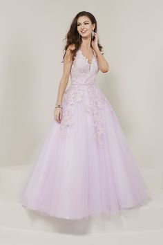 3abcc4a3169c9 Tiffany Designs 16332 is a sleeveless V neck prom gown with metallic lace  Appliques bodice and beaded waistline, Tulle A-Line skirt, open V back, ...