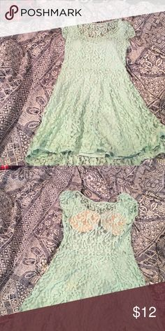 Urban Outfitters sun dress Perfect condition. Open back. Cannot wear a bra with it so I put in padding. Can remove padding if you want. Size S. beautiful mint color. Urban Outfitters Dresses Mini