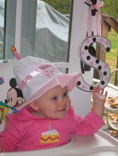 First birthday party idea..    Put the birthday girl's initals behind her. Cute for pics :)