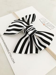 Make a statement with this cute headband! Bow measures approximately 3.5 across. Not too big and not too small. A black and white striped grosgrain ribbon is hand tied around a super soft and stretchy nylon headband in nude or ivory. Nylon headbands comfortably fit newborns through adults. Perfect for your growing baby! ::Please see shop policies regarding turnaround time and FAQ:: ***Reminder*** Accessories for small children should be worn under adult supervision Funny Photo Booth, Baby Barn, Kids Headbands, Candy Crafts, Little Girl Hairstyles, Girls Hair Accessories, Baby Girl Fashion, Auntie, Diy Crafts To Sell