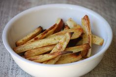 Parsnips are so sweet and tasty (and seasonal!), and roasting just intensifies the sweetness. These Baked Parsnip Fries couldn't be easier -- just parsnips, olive oil, garlic powder, salt, and pepper.