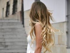 Long blonde ombre hair.