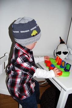 I made a hat like this, with lots of car buttons, for Ervin last year. He still has never worn it. :(