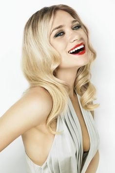 OLSENS ANONYMOUS FASHION STYLE BLOG ASHLEY MARIE CLAIRE OUTTAKE 2007 RETRO LOOSE WAVES CURLS RED LIPS SILVER PLEATED LOW CUT DRESS SMILE SMILING