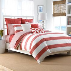 Refresh your master suite or guest room with this lovely comforter set, showcasing coral-hued striping for eye-catching appeal.  Pro...