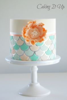 Fish scale pattern on silver leaf with fondant flower feature www.facebook.com/cakingitup