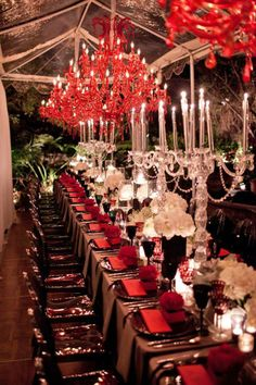 Dramatic red chandeliers in a clear tent