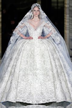 Zuhair Murad Couture Spring/Summer 2016 Bridal gown in white tulle sprayed with shimmering organza floral appliques and showers of pearls and crystals