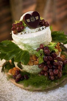 Cheese wedding cake adorned with grapes and apricots. Yum!