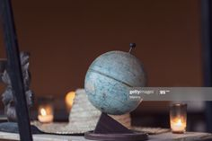 Stock Photo : Close-up of a globe standing on a table with a hat and candles in the background. Marrakesh, Marrakesh-Safi, Morocco.