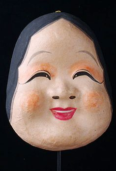 Japanese Otafuku mask  Japan  8 inches, painted papier mache  Also known as Uzumi or Okame, Otafuku is the name for the female half of a traditional Japanese Kyogen theatre pair  She is considered to be the goddess of mirth and is frequently seen in Japanese art.  Part of the Kyogen category of masks, this is a character used for the comic interlude in classic Noh plays. It is also popular with street performers and the general public