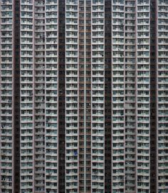 Mind-boggling: Photographer Michael Wolf's incredible shots capture the extreme scale of skyscrapers in one of the world's most densely populated places; Hong Kong