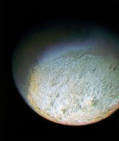 This color photo of Neptune's largest moon Triton was obtained by NASA's Voyager 2 probe on Aug. 24, 1989, from 330,000 miles away. The resolution is about 6.2 miles, sufficient to begin to show topographic detail.  Credit: NASA/JPL