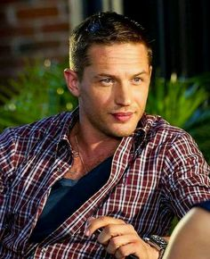 Tom Hardy --- if I was out in public sitting across from him at a table, would I just grab his face and kiss him? you bet I would! lol!