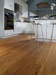 Bamboo made the list of beautiful kitchen flooring ideas because it's chic, affordable and renewable!