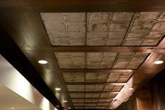 $30 each panel. Reclaimed roof tiles, reused for detailed ceiling.