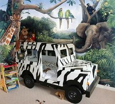 Rainforest jungle theme...love the jeep bed!