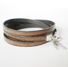 distressed brown leather wrap bracelet, unisex cuff, angel wings, boho chic, rocker style by jcudesigns on Etsy https://www.etsy.com/listing/161943287/distressed-brown-leather-wrap-bracelet