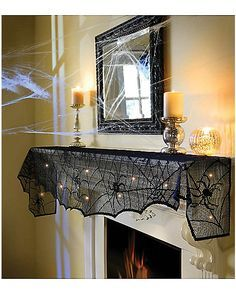 Spider Mantel Cover  - Spirithalloween.com   The lighted fabric resembles spider webs with just the right amount of ambiance.