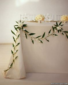 simple garland for top table, cake and buffet tables