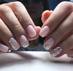 Pale pink nails with chunky silver glitter accent nails.