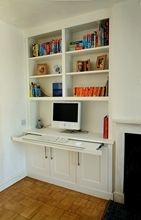 Built in Alcove cabinet design pull out desk cabinets and book shelves - bloody brilliant