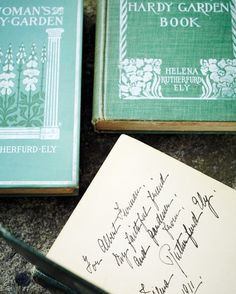 """Ely's first book, A Woman's Hardy Garden, was a best seller and was printed 16 times; she wrote two subsequent books, including The Practical Flower Garden, a copy of which is shown here, signed to her """"faithful friend and gardener,"""" Albert Furman."""