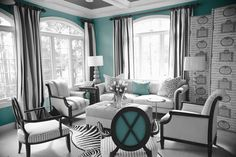 A very small dose of teal brings this white and brown formal living room to life.  The accents of brown in the curtain and the furniture adds depth; the combination of stripes and architecturally patterned wallpaper adds texture a type of tone on tone texture which allows the blue to pop out even more.  Grandin Road Color Crush on Laguna.