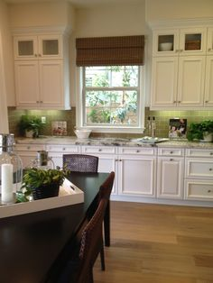 white kitchen cabinets white cabinets black countertops and backsplash tile on 1036